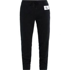 167238b116a63 ... Kolekcja wiosna 2019. Calvin Klein Jeans PERSIS TRUE ICON TRACK PANT  Spodnie treningowe black. Czarne spodnie dresowe damskie ...