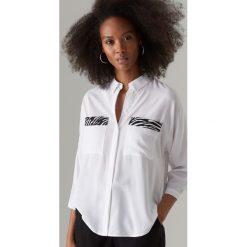 136f84197cb0cc Koszula z motywem zwierzęcym - Biały. Koszule damskie Mohito. Za 99.99 zł.
