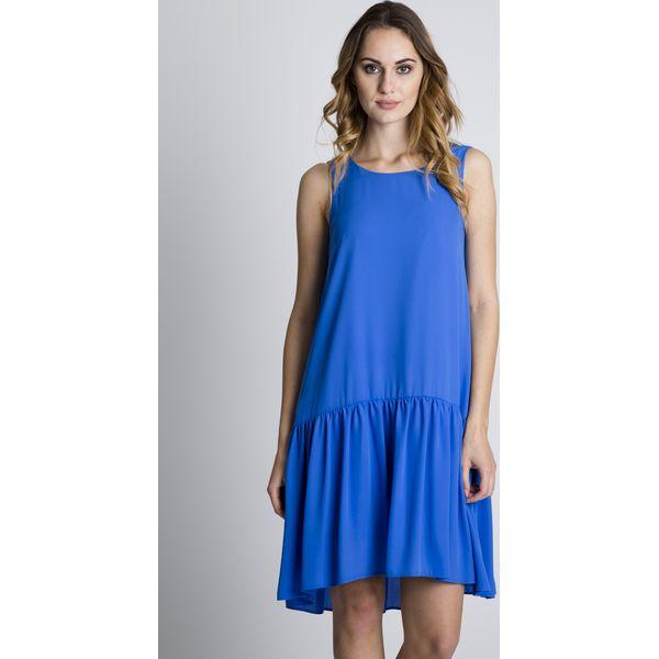 10eda71501 Niebieska oryginalna sukienka z falbaną u dołu BIALCON - Sukienki ...