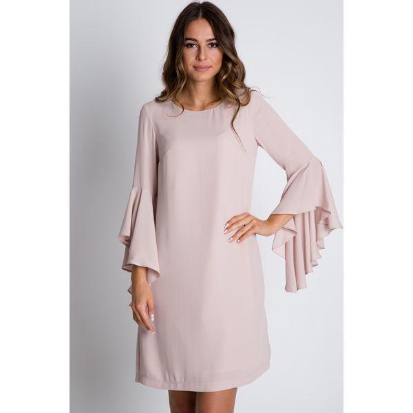 3e8dc8ed03 Pudrowa sukienka z rozkloszowanymi rękawami BIALCON - Sukienki ...