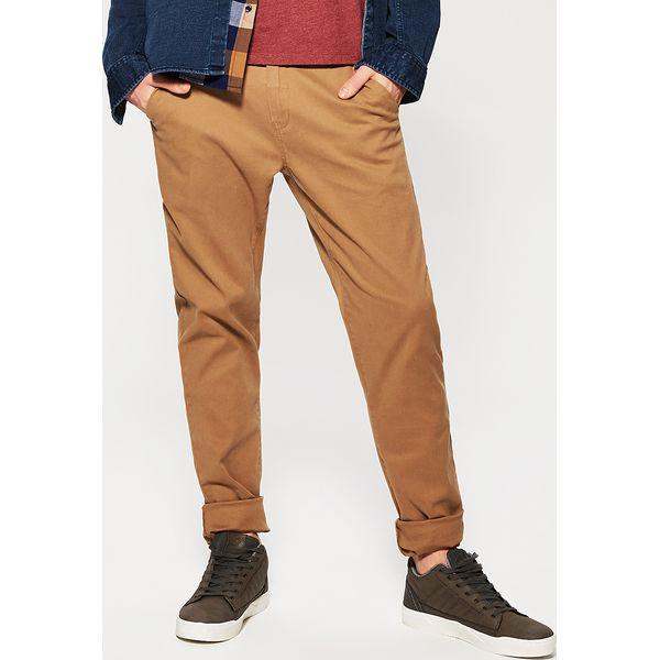 d0d77f06954bc Materiałowe spodnie chino - Beżowy - Spodnie materiałowe męskie ...