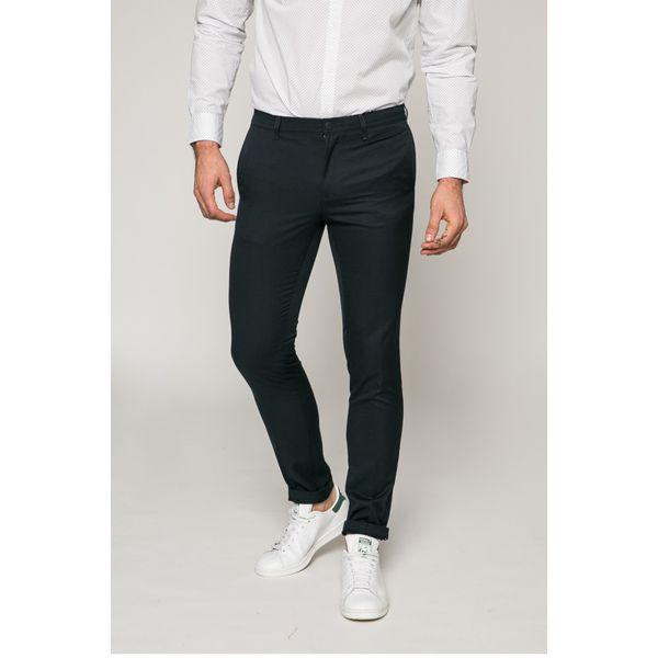 064533525d270 Tommy Hilfiger - Spodnie - Szare spodnie materiałowe męskie marki Tommy  Hilfiger