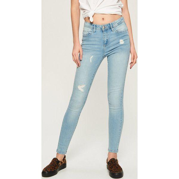 Jeansy skinny z przetarciami Niebieski