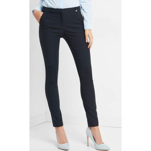 4ae815c58e111b Dopasowane spodnie w kant - Spodnie materiałowe damskie Orsay. Za ...