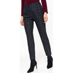 Spodnie w kratę Spodnie damskie Kolekcja wiosna 2020