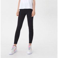 Czarne spodnie damskie ze sklepu House Kolekcja zima 2020
