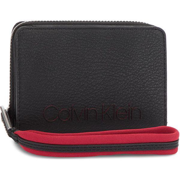 56e0652fe0457 Duży Portfel Damski CALVIN KLEIN - Pop Touch Medium Zip K60K604313 001 -  Czarne portfele damskie marki Calvin Klein
