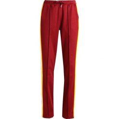 fdf4c003e460f Calvin Klein Jeans SIDE STRIPE TRACK PANTS Spodnie treningowe cabernet.  Spodnie sportowe damskie marki Calvin ...