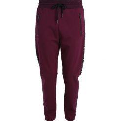 582b8a82591a Onepiece SPRINTER Spodnie treningowe burgundy. Czerwone spodnie dresowe  damskie Onepiece